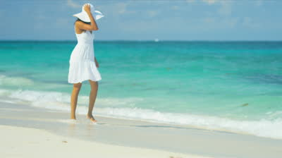 stock-footage-beautiful-ethnic-girl-white-summer-dress-splashing-waves-on-luxury-resort-beach-shot-on-red-epic
